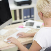 elegant woman working in font of her computer